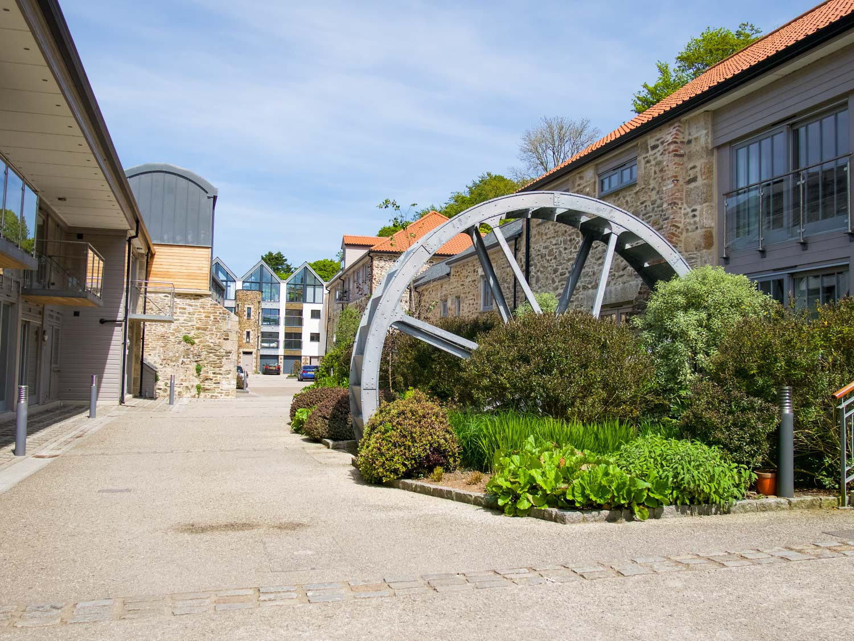 A Beautiful Water Wheel is located outside Sabusita